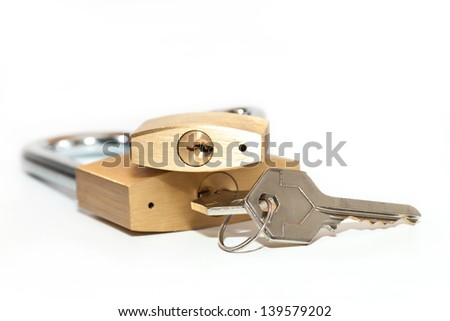The keys in the lock on a white background - stock photo