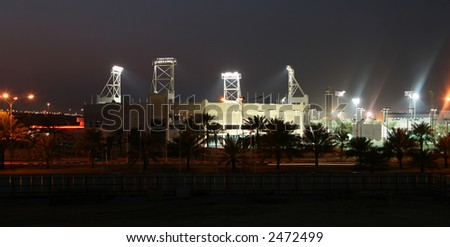 The Khalifa tennis stadium in Doha, Qatar, at night - the site of all the main Qatar professional tennis tournaments - stock photo