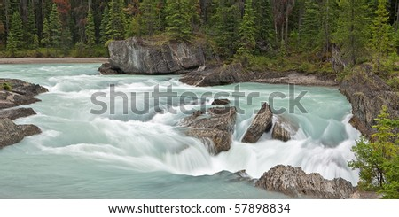 The Kicking Horse River flows into the Natural Bridge at Yoho National Park, British Columbia. - stock photo