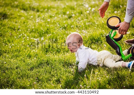 The kid fell off his bicycle - stock photo