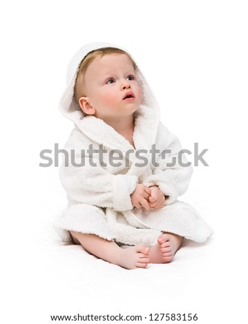 the kid in a bathing dressing gown on a white background - stock photo