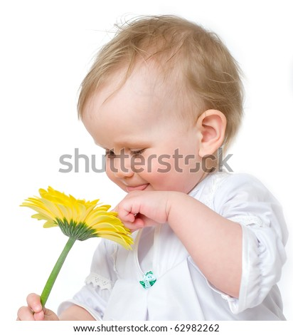 The kid on a white background with natural flowers. A high key  portrait - stock photo