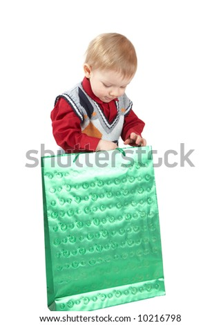 The kid opens green package - stock photo