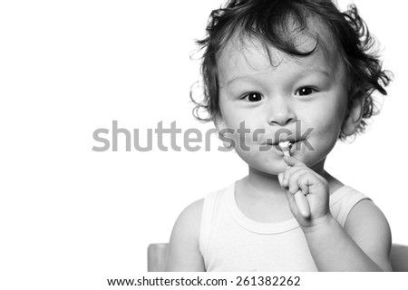 The kid to study to clean a teeth. - stock photo