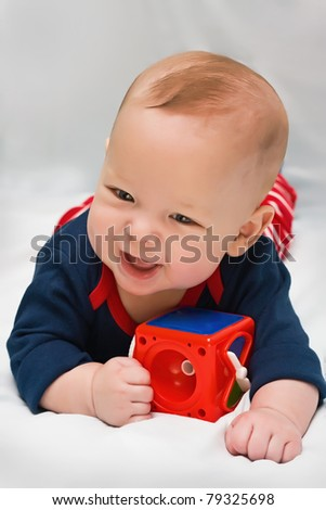 The kid with a toy on a light background - stock photo