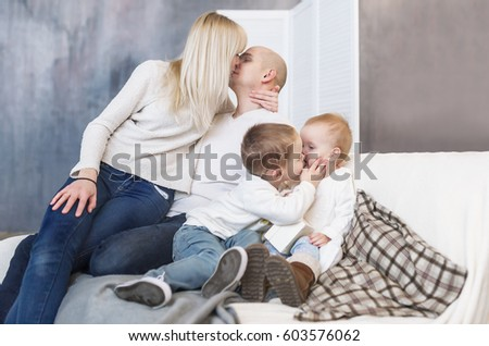 The kissing parents and children. Family happiness and love. Happy parents and children