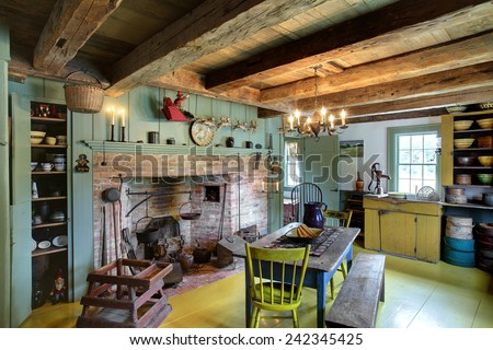 The Kitchen Dining Room And Fireplace In A 17th Century Primitive Colonial Style Home