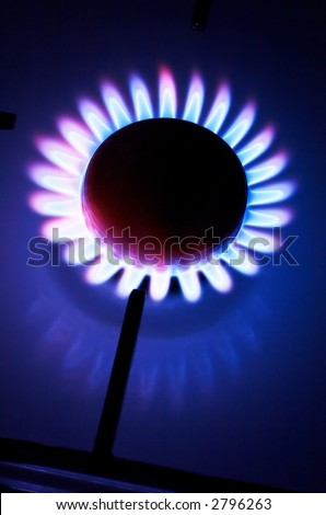 The kitchen gas cooker with burning fire - stock photo