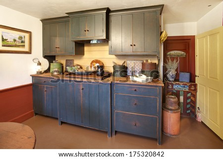 Captivating The Kitchen In A Primitive Colonial Style Reproduction Home, Built With  Materials Reclaimed From Structures