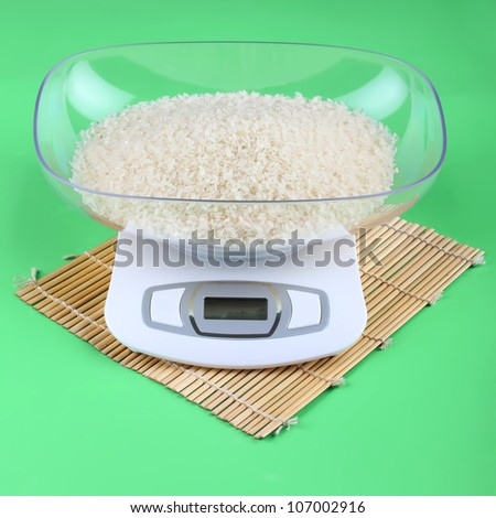 the kitchen scale with rice - stock photo