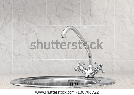 The kitchen water crane - stock photo