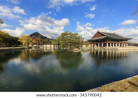 The korean traditional garden(building, house) with pond(water), reflection, 'Gyeonghoeru' at the korean royal palace(Gyeongbokgung) in the blue sky, seoul at the fall(autumn, october, september)