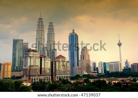 The Kuala Lumpur city skyline - with both the Petronas Twin Towers and KL Tower - stock photo