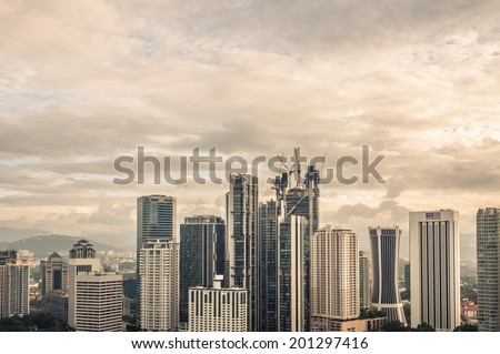The Kuala Lumpur skyline continues to expand under heavy construction. - stock photo
