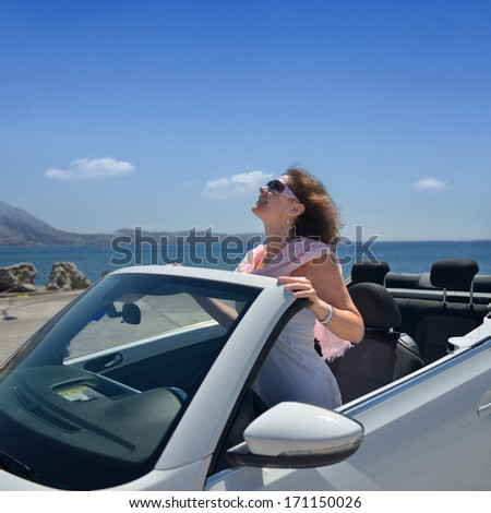 The lady at the resort on the beach in the car