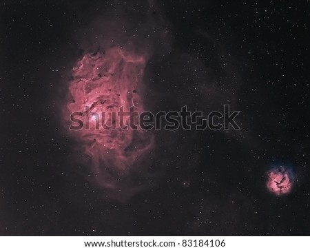 The Lagoon and Trifid Nebulae in Hydrogen and Oxygen False Color - stock photo