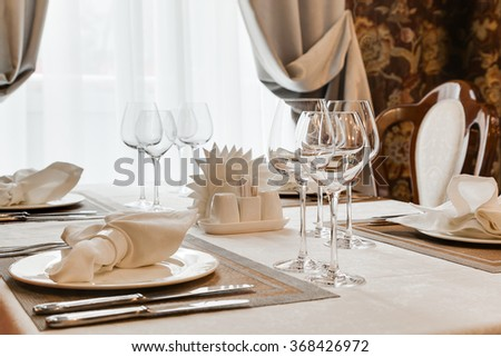 The laid table at restaurant in classical style