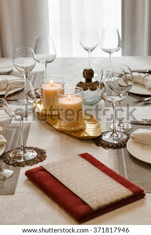 the laid table with candles at restaurant in classical style - stock photo