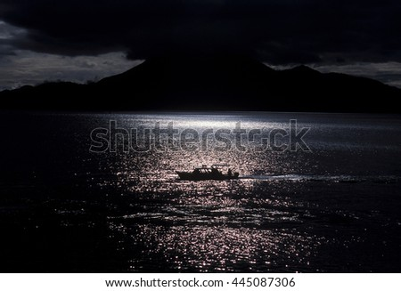 The Lake Atitlan mit the Volcanos of Toliman and San Pedro in the back at the Town of Panajachel in Guatemala in central America.    - stock photo