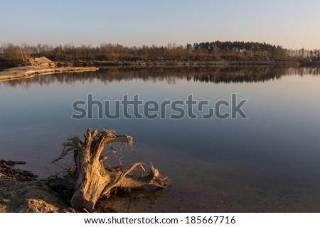 The lake Klausensee next to Schwandorf in Bavaria at sundown - stock photo