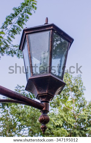 The lamp post on the blue sky background
