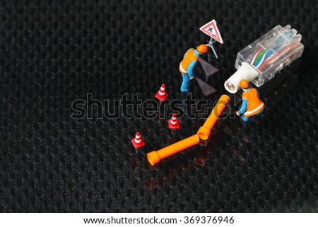 The lan connection damaged cable plug and maintenance figure miniature model represent the computor business and technology concept related idea.  - stock photo