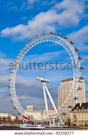 "The landmark of the ""London Eye"" set against a bright spring sky - stock photo"