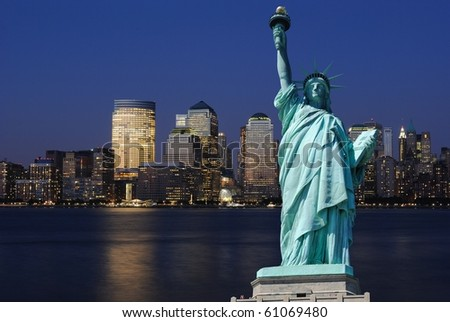 The landmark Statue of Liberty against the impressive New York City skyline. - stock photo