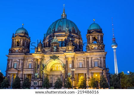 The landmarks Dom and TV Tower in Berlin at night - stock photo