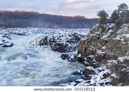 The landscape at Potomac Gorge includes the Great Falls of the Potomac, a series of dramatic cascades forced through narrow Mather Gorge as the river drops nearly 80 feet over less than a mile.   - stock photo