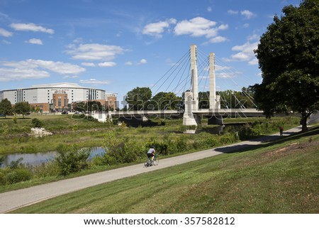 The Lane Avenue bridge in Columbus, Ohio is enjoyed by bikers and runners along the Olentangy River. - stock photo