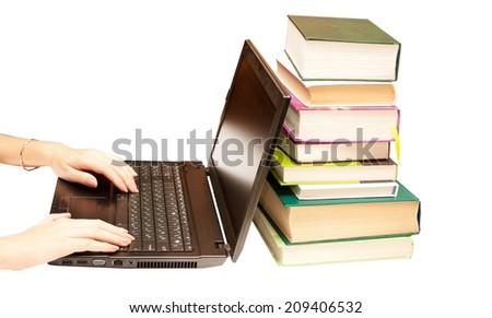 The laptop and books, encyclopedias on a white background - stock photo