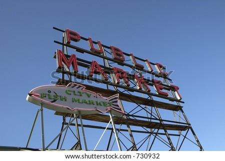 The large neon sign that says Public Market at the pike place market seattle - stock photo