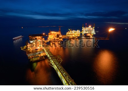 The large offshore oil rig platform at night in the gulf of thailand - stock photo
