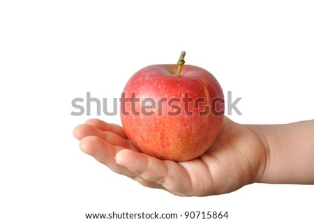 The large red apple lying in the palm of the boy, isolated - stock photo