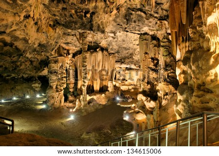 The largest chamber of the Cango Cave. Shot in Karoo near Oudtshoorn, South Africa. - stock photo