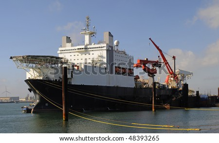 The largest pipe-laying ship in the world at 300 metres (984 ft) long (excluding pipe-laying apparatus) and 96,000 tonnes. - stock photo