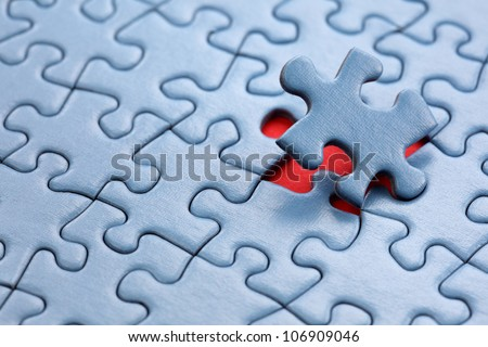 The last piece of jigsaw puzzle concept for solution and completion - stock photo