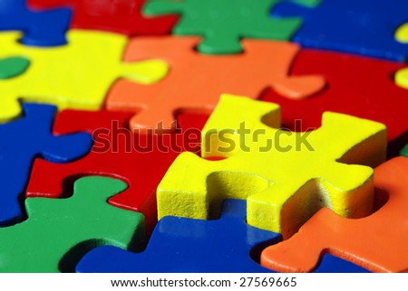 The last puzzle piece coming down into it's place - stock photo