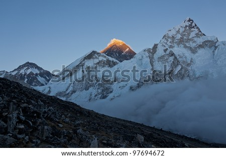 The last rays of the setting sun on the top of Everest - Nepal - stock photo