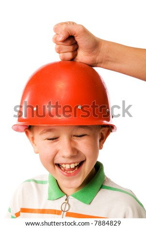 The laughing boy in a protective helmet on a white background - stock photo