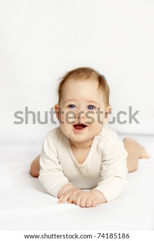 The laughing little girl on a white background