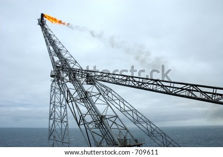 The leaning offshore oil rig flare boom