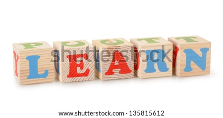 The Learn word from wooden cubes isolated on a white background - stock photo