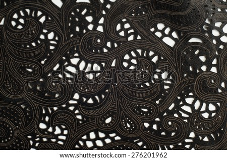 The leather texture with a broken red lace pattern,   Photography Studio - stock photo