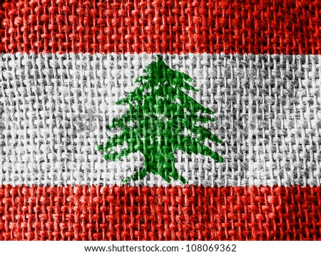 The Lebanese flag painted on fabric surface - stock photo
