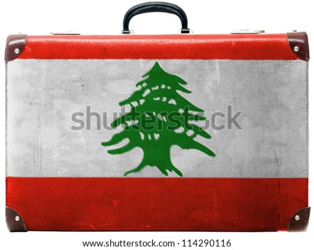 The Lebanese flag painted on old grungy travel suitcase or trunk - stock photo