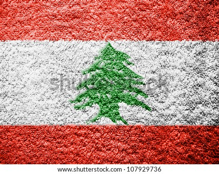 The Lebanese flag painted on towel surface - stock photo