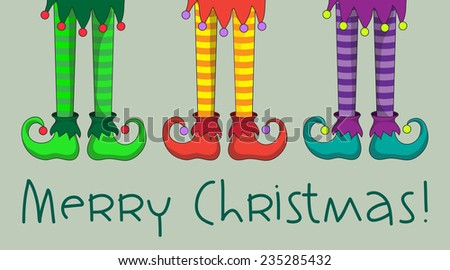 The legs and shoes of Santa's elves.  - stock photo