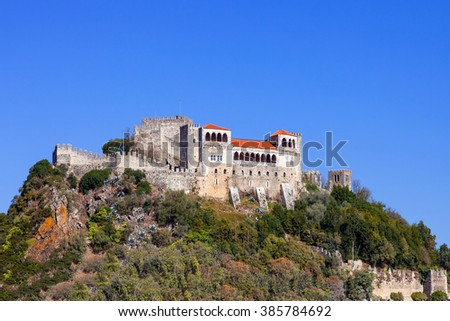 The Leiria Castle built on top of a hill with a view over the gothic Palatial Residence area (Pacos Novos). Leiria, Portugal. - stock photo